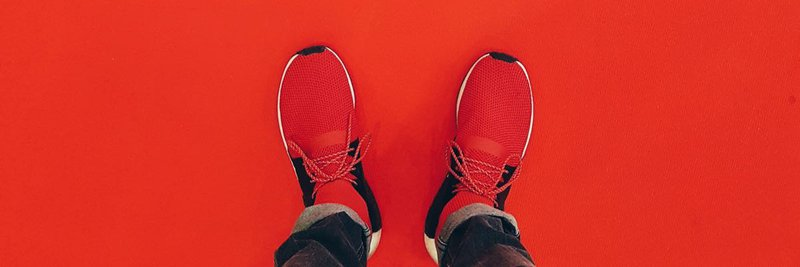 podcast cover art person wearing red running shoe
